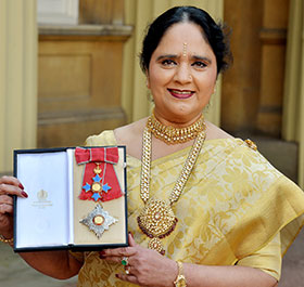 Dame Asha with her DBE insignia